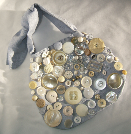 silk purse decorated with old buttons